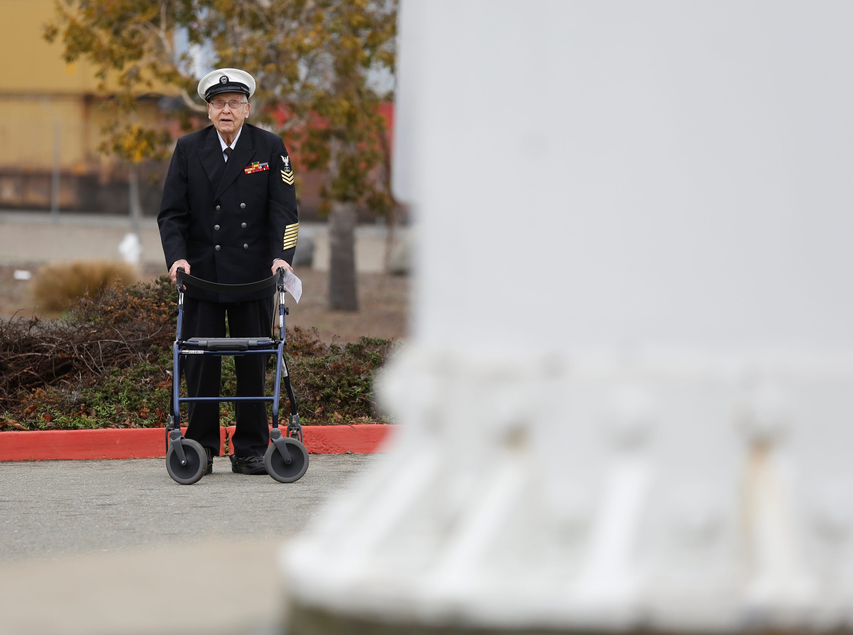 WWII veteran Robert Almquist, 95, from Wisconsin looks up at the mast of the ship he served on, the USS Oakland, that stands at Middle Harbor Shoreline Park in Oakland, Calif., on Friday, Jan. 11, 2019. The Almquist family had raised money on a GoFundMe page to bring the World War II Navy veteran to the West Coast to visit the mast and to see a plaque bearing his name at the Mt. Soledad National Veterans Memorial in La Jolla. Visit Oakland sponsored Almquist to come to Oakland.  (Laura A. Oda/Bay Area News Group)