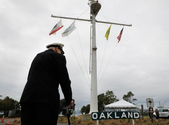 WWII veteran Robert Almquist, 95, from Wisconsin visits the mast of the ship he served on, the USS Oakland, that stands at Middle Harbor Shoreline Park in Oakland, Calif., on Friday, Jan. 11, 2019. The Almquist family had raised money on a GoFundMe page to bring the World War II Navy veteran to the West Coast,  to visit the mast and to see a plaque bearing his name at the Mt. Soledad National Veterans Memorial in La Jolla. Visit Oakland heard about the fund raising and decided to pay for Almquist's flight to Oakland.