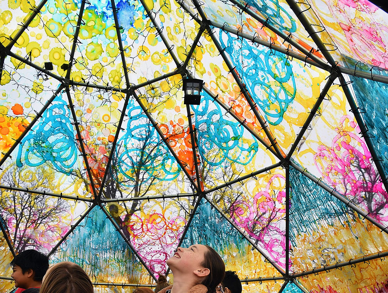 Lauren Pham and about 50 other Olney Elementary fifth graders explored the Wichita Dome art installation at Nexus Square during a field trip Friday morning.