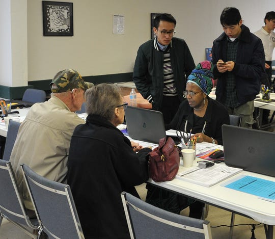 VITA (Volunteer Income Tax Assistance), volunteers and clients use the recently opened facility located on Armory road to file taxes, Friday morning.  VITA is a program that offers free tax help for people with disabilities, speaks limited English, and make $54,000 or less.