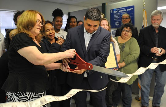 Volunteer Income Tax Assistance, program director, Genevieve Anderson, left, and Wichita Falls mayor, Stephen Santellana cut a ribbon during a ceremony held to celebrate the opening of the Volunteer Income Tax Assistance location on Armory Road, Friday morning.