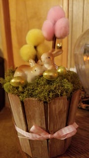 Embellish and decorate your planter. Here is one with an Easter theme. Several of these would look good as a table centerpiece for Easter lunch. You could also do it for Valentine's Day, Fourth of July, etc.