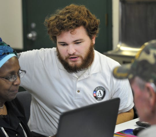 Americorp, VITA (Volunteer Income Tax Assistance, volunteer Kyle Lemmerman works to help VITA clients file their tax forums Friday morning. VITA is a program that offers free tax help for people with disabilities, speaks limited English, and make $54,000 or less.