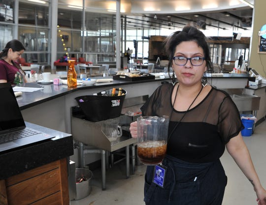 Southern Girls Cafe & Catering, Operations Coordinator, Courtney Ragsdale prepares to top-off refreshments, Friday afternoon at their restaurant located inside the Wichita Falls Reginal Airport. Ragsdale and the restaurant owner, Tamitha Bailey, decided to give free burgers to government employees that had been furloughed during the government shutdown.