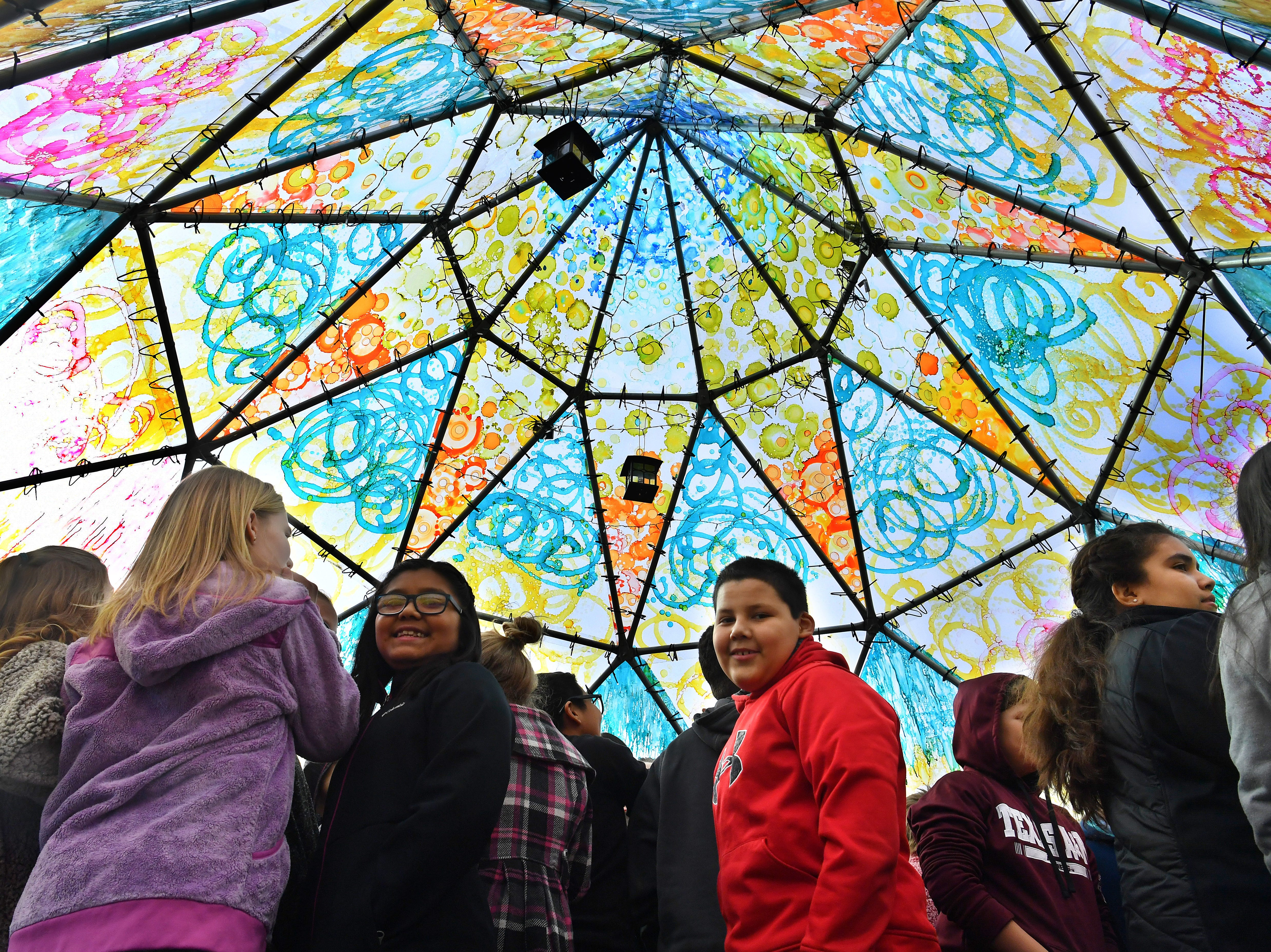 Fifth graders from Olney Elementary learned about art and Native American culture during a visit to the Wichita Dome at Nexus Square Friday.