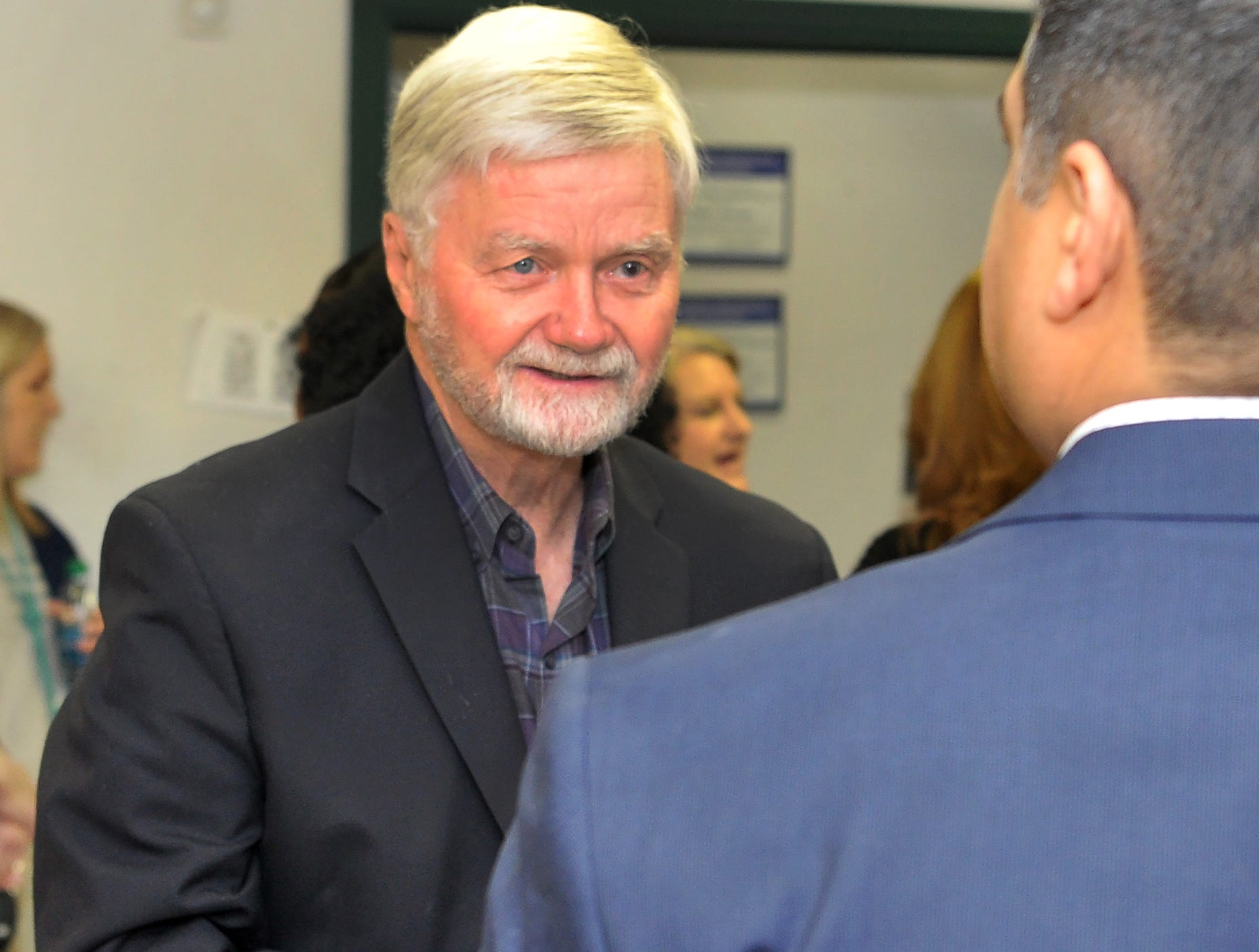 Wichita County Judge, Woody Gossom, left, and Wichita Falls mayor, Stephen Santellana chat before a ribbon cutting ceremony held to celebrate the opening of Volunteer Income Tax Assistance (VITA) location on Armory Road, Friday morning.