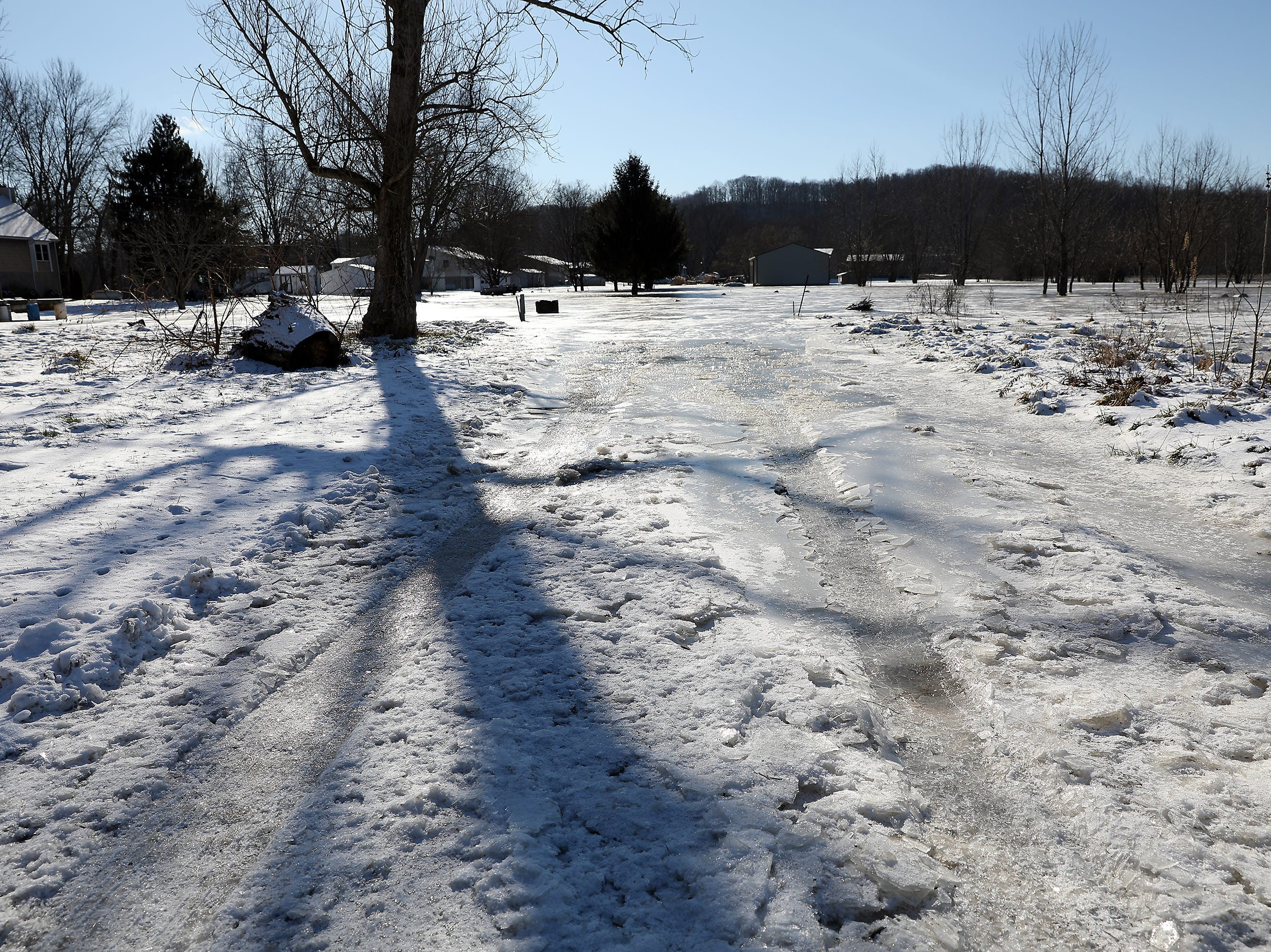 Ice covers part of Shady Lane south of Gaysport Friday afternoon.