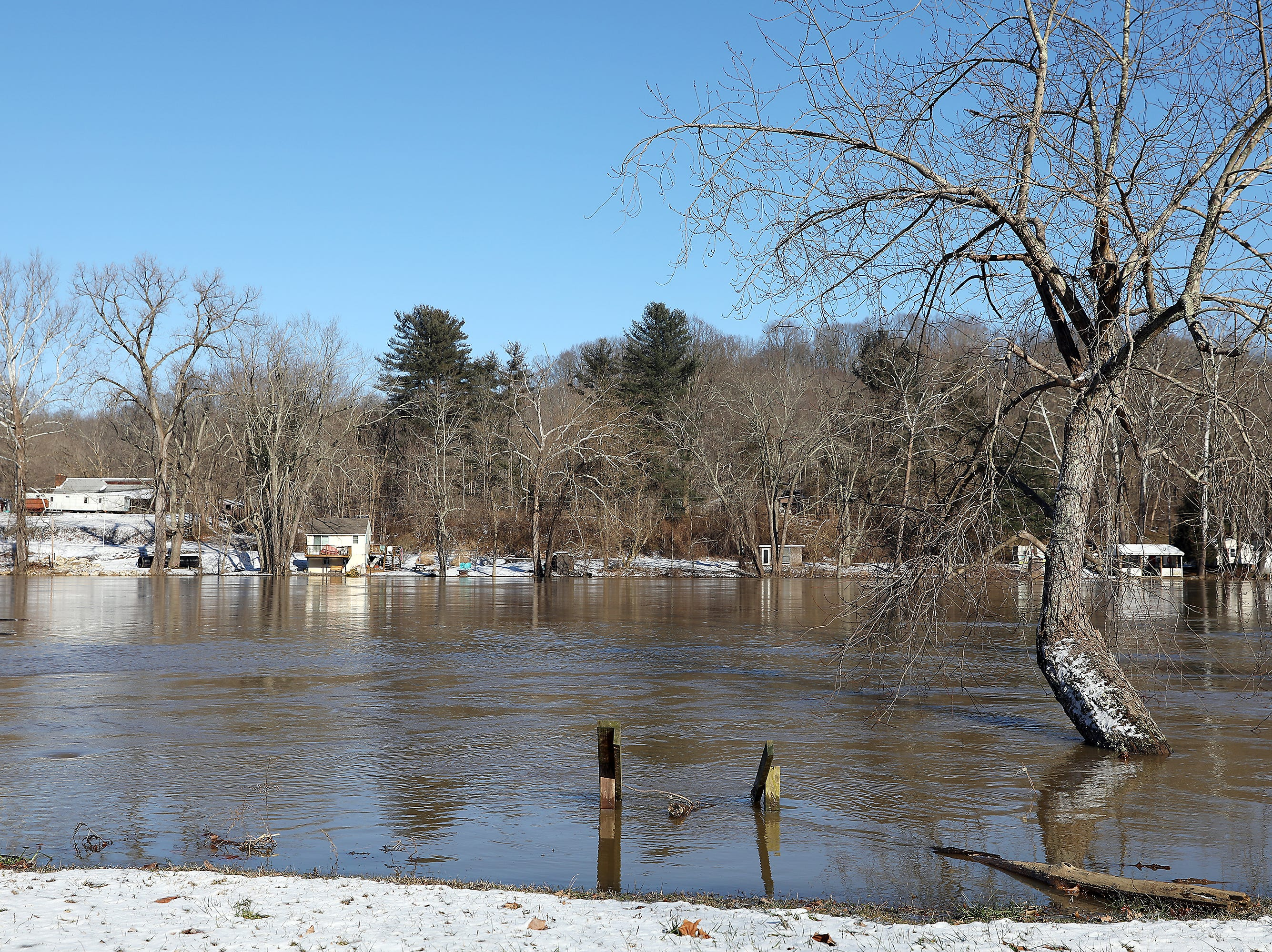 The Muskingum creeps up to the edge of Old River Road south of Gaysport Friday afternoon.