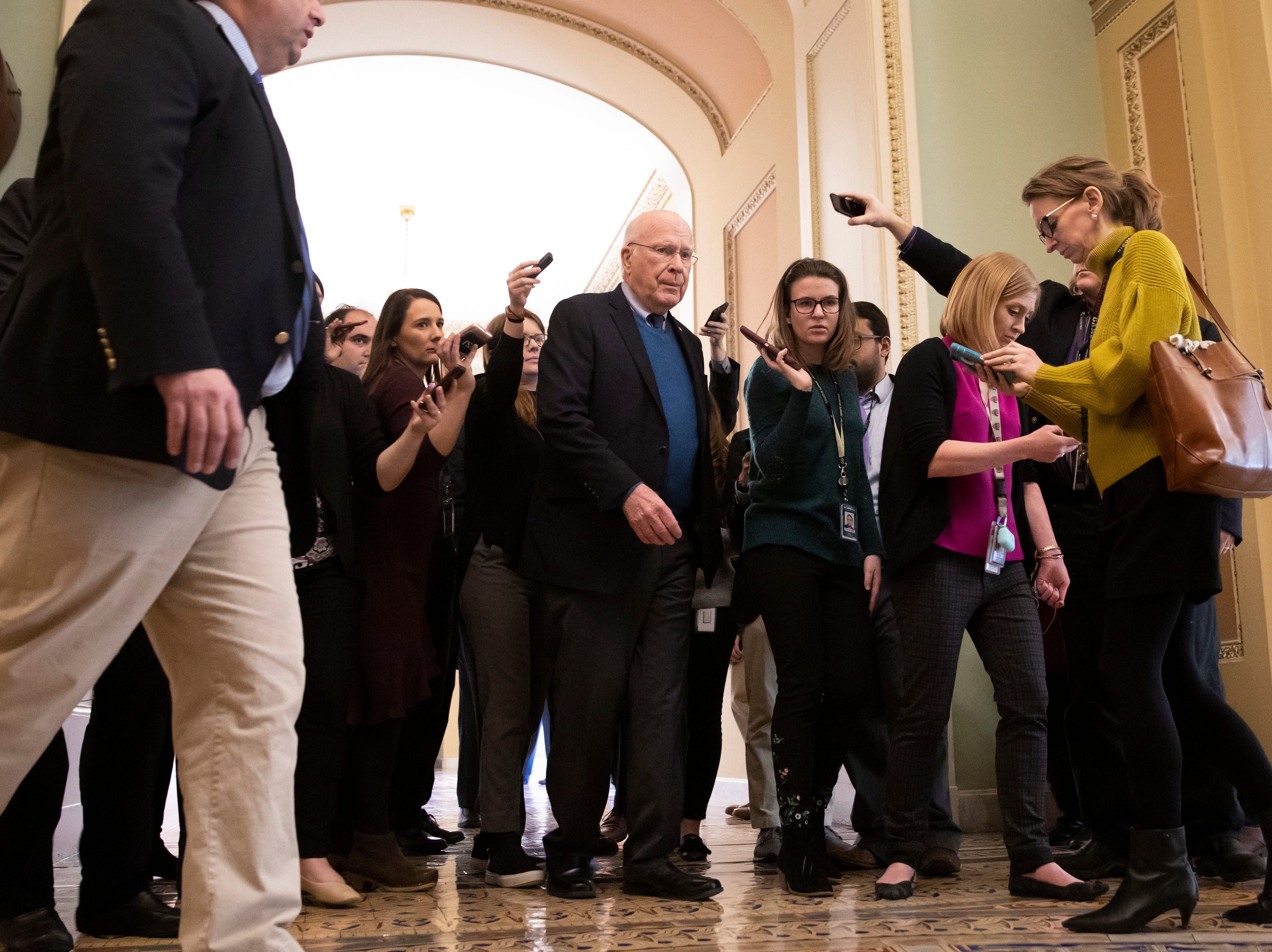 Democratic Senator from Vermont Patrick Leahy, center, walks near the Senate chamber before President Donald J. Trump agreed to end the partial government shutdown, at the US Capitol in Washington, DC on Jan. 25, 2019.