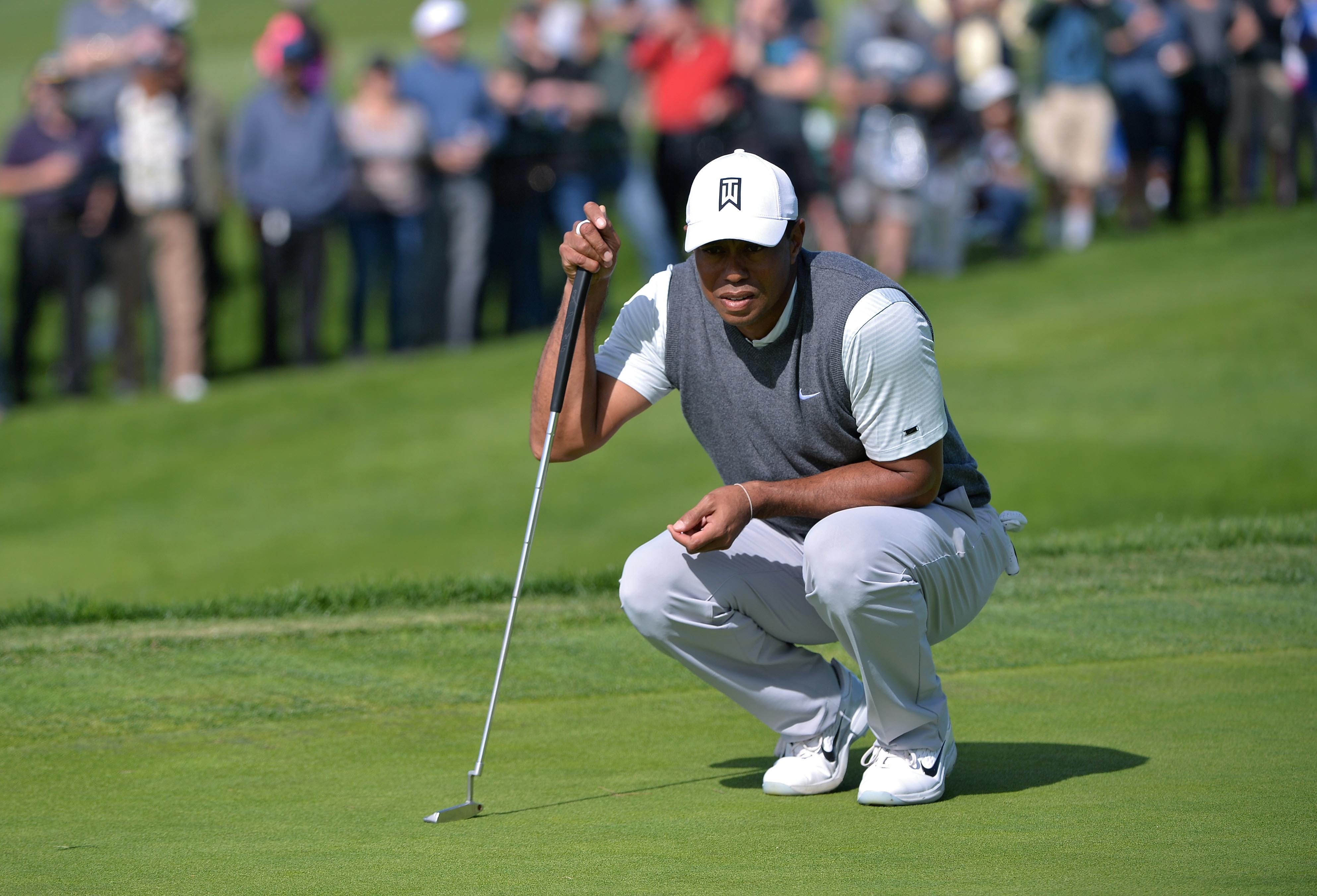 Tiger Woods shot a 2-under 70 in the opening round of the Farmers Insurance Open.