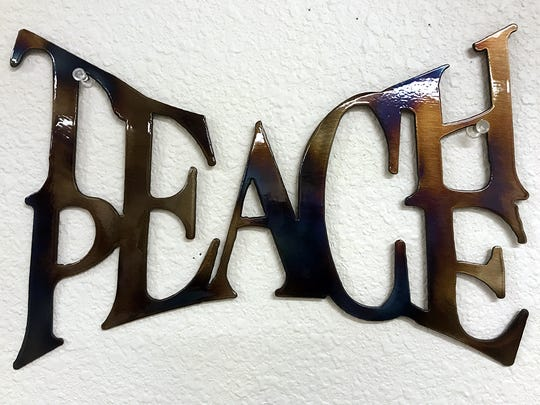 This sign hangs in the New Mexico classroom of history teacher Ned Dougherty, the latest in a line of local teachers to lead Taos High students through a three-day retreat experience meant to help them take care of their emotional and mental health.