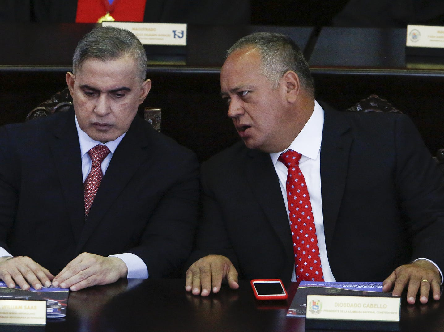 President of the Constituent Assembly Diosdado Cabello (R) talks to Maikel Perez President of the Supreme Tribunal of Justice of Venezuela before the speech of Nicolas Maduro in front of judges and members of the Supreme Justice Tribunal on its annual opening day of sessions, Thursday, in Caracas, Venezuela.