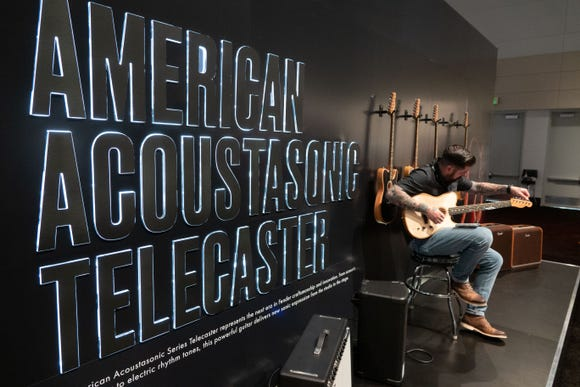 An exhibit for Fender's new American Acoustasonic Telecaster, a combo acoustic guitar that can also be played as a rocking Telecaster guitar.