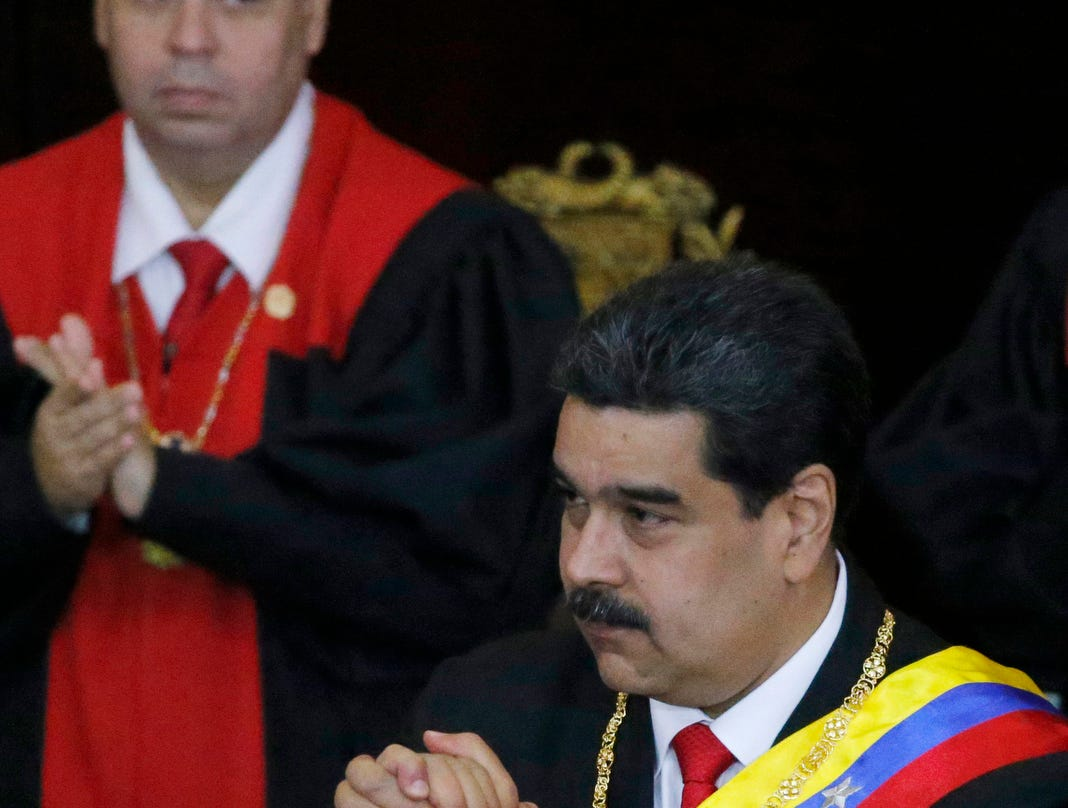 Venezuelan President Nicolas Maduro gestures before guests at the Supreme Court during an annual ceremony that marks the start of the judicial year in Caracas, Venezuela, Thursday. Venezuelans are heading into uncharted political waters after the young leader of a newly united opposition claimed Wednesday to hold the presidency and Maduro dug in for a fight with the Trump administration.
