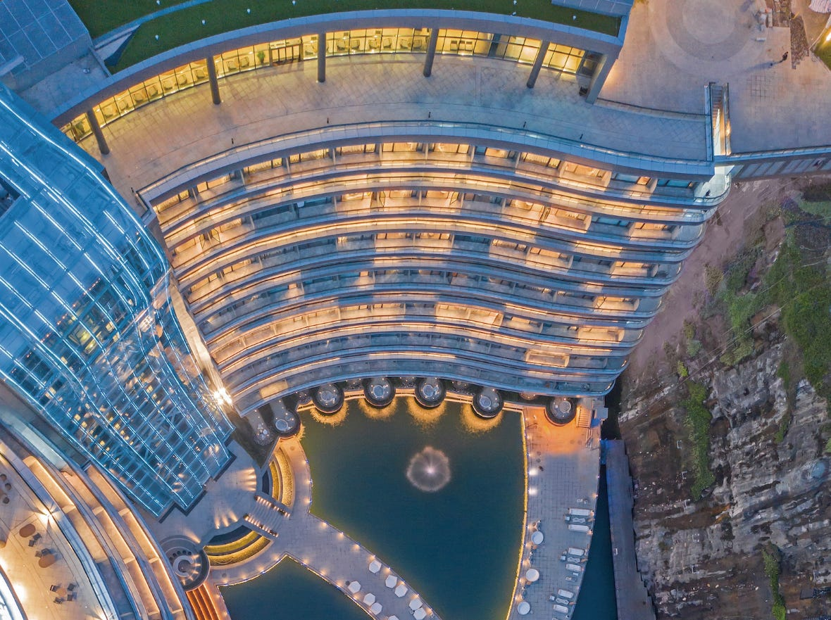 While guests will surely spend most of their time enjoying the indoor amenities, there is plenty to do outside as well. To get the lay of the land, this outdoor viewing deck gives visitors a birds-eye view of the property's yin-yang design giving all guest rooms panoramic balcony space. The design also pays homage to the unique connection between city and nature found at the property. The vertical glass atrium running down the side of the hotel is meant to look like a waterfall.