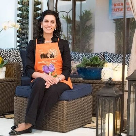 Hila Roberts, a Home Depot merchant, is the primary caregiver for her children when her husband is on the road, but it hasn't hindered her ascent up the corporate ladder.