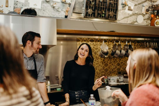 Alex Snodgrass, author of The Defined Dish, talks at a Chicago Say Hello Wellness event, a cooking class where she taught participants to make a healthy rendition of taquitos with avocado crema sauce
