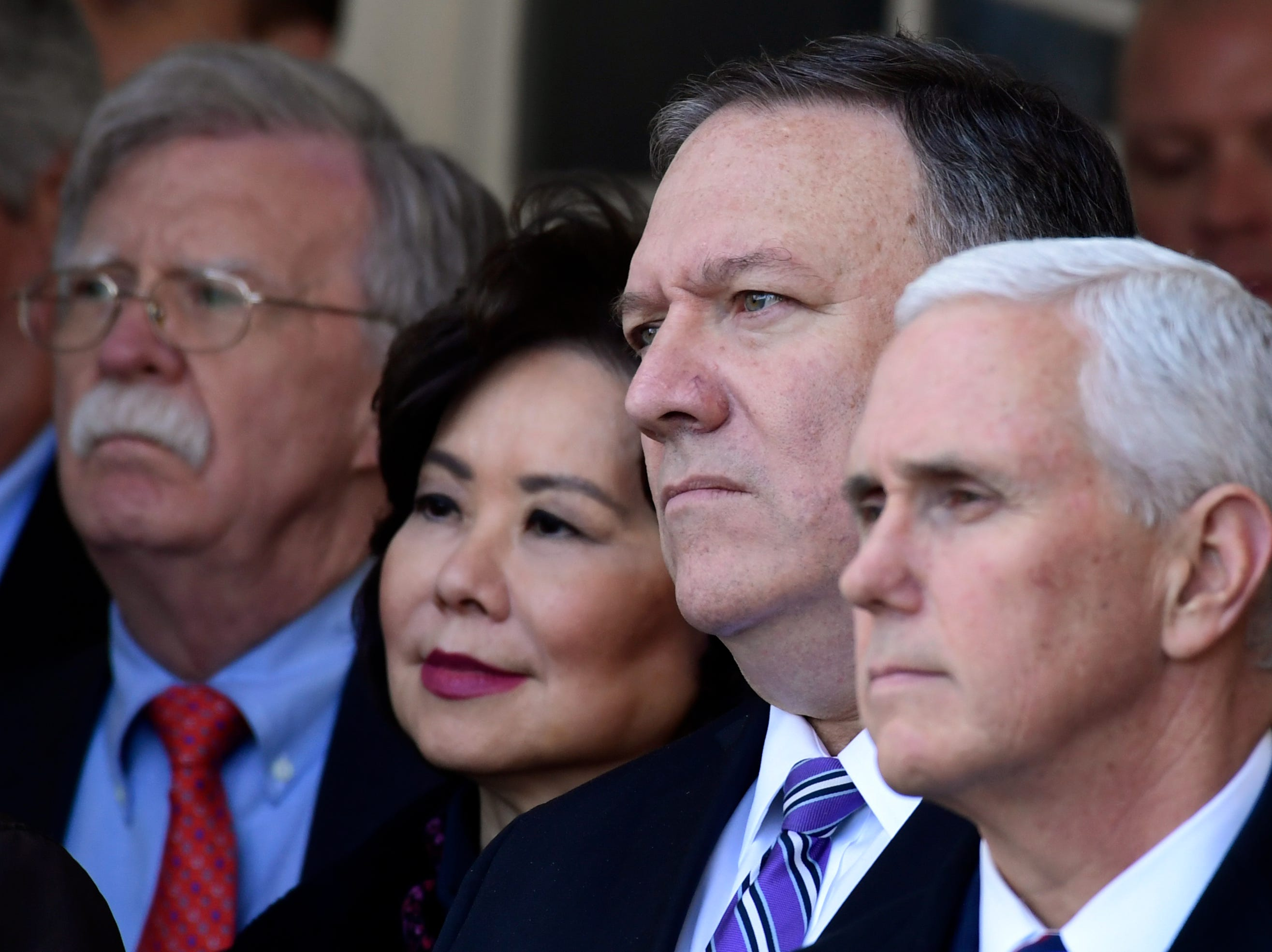 National security adviser John Bolton, left, Transportation Secretary Elaine Chao, second from left, Secretary of State Mike Pompeo, second from right, and Vice President Mike Pence, right, listen as President Donald Trump speaks in the Rose Garden of the White House in Washington, Friday, Jan. 25, 2019, to announce a temporary deal to open the government.