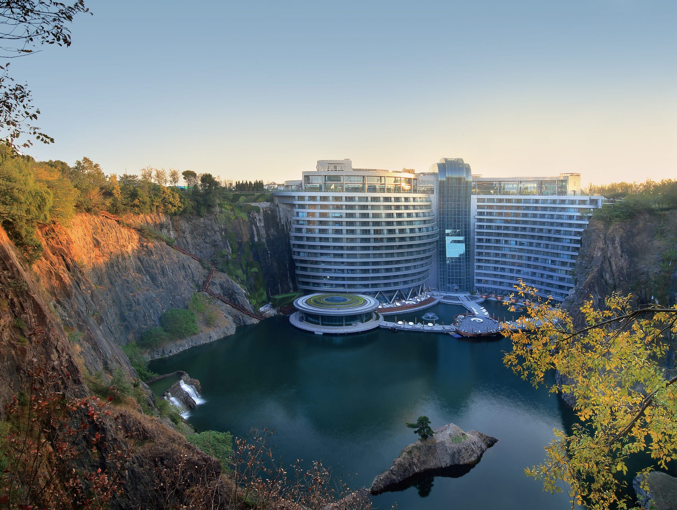 The location of the hotel was positioned to maximize exposure to the sun so that it could harvest solar (and water) energy to as much of the hotel operation as possible. It uses the quarry's own microclimate and unique thermal inertia to help cool the building in summer and warm it in winter. Winds from the north can easily cool the area. Nearly $300 million dollars went into the design and construction of this landmark project, which became an instant hit with Chinese visitors. The international guest list is expected to grow quickly.