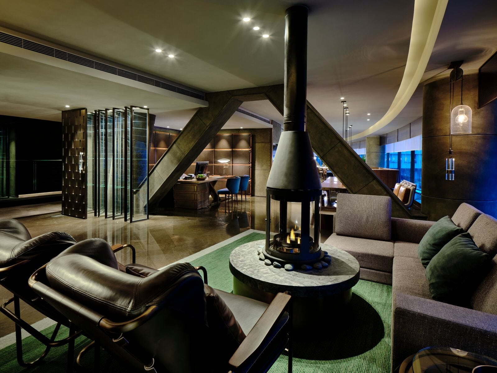 The rustic-chic vibe in the lounge extends to this modern fireplace surrounded by leather chairs (the hotel is near the Sheshan Mountains, after all). Here, guests can sip complimentary wine or cocktails each evening while planning out their recreational activities for their stay.