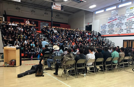The freshman class at Taos High in New Mexico sat in bleachers to hear from history teacher Ned Dougherty and the seniors who participated in the annual three-day retreat in October.