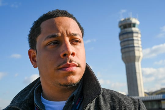 Aubrey Farrar, 30, works as an air traffic management coordinator at Ronald Reagan Washington National Airport outside Washington, D.C.