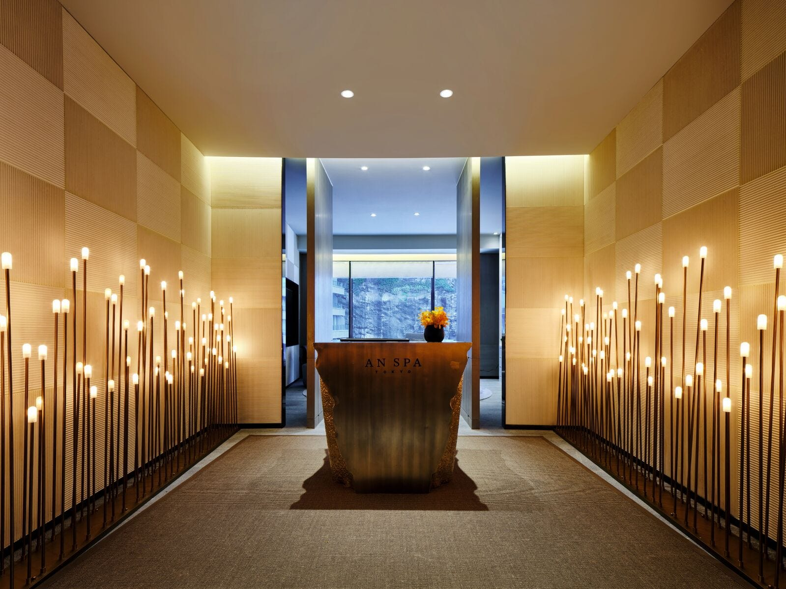 Even the torch-lined entrance to the spa is made to transport you away from city life and into an oasis overlooking the quarry.