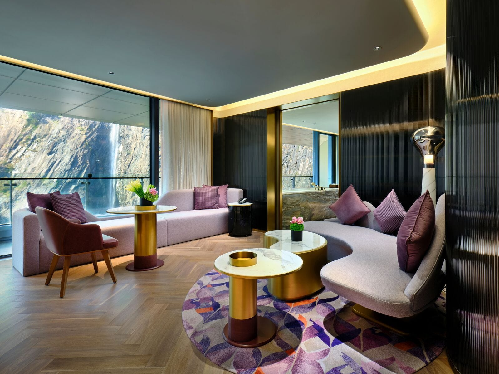 Some of the bigger suites have excellent views of the waterfall on another side of the quarry. They extend living areas with modern decor, which (like in the rest of the rooms here) come equipped with power outlets and USB ports by the sofas or lounge chairs.