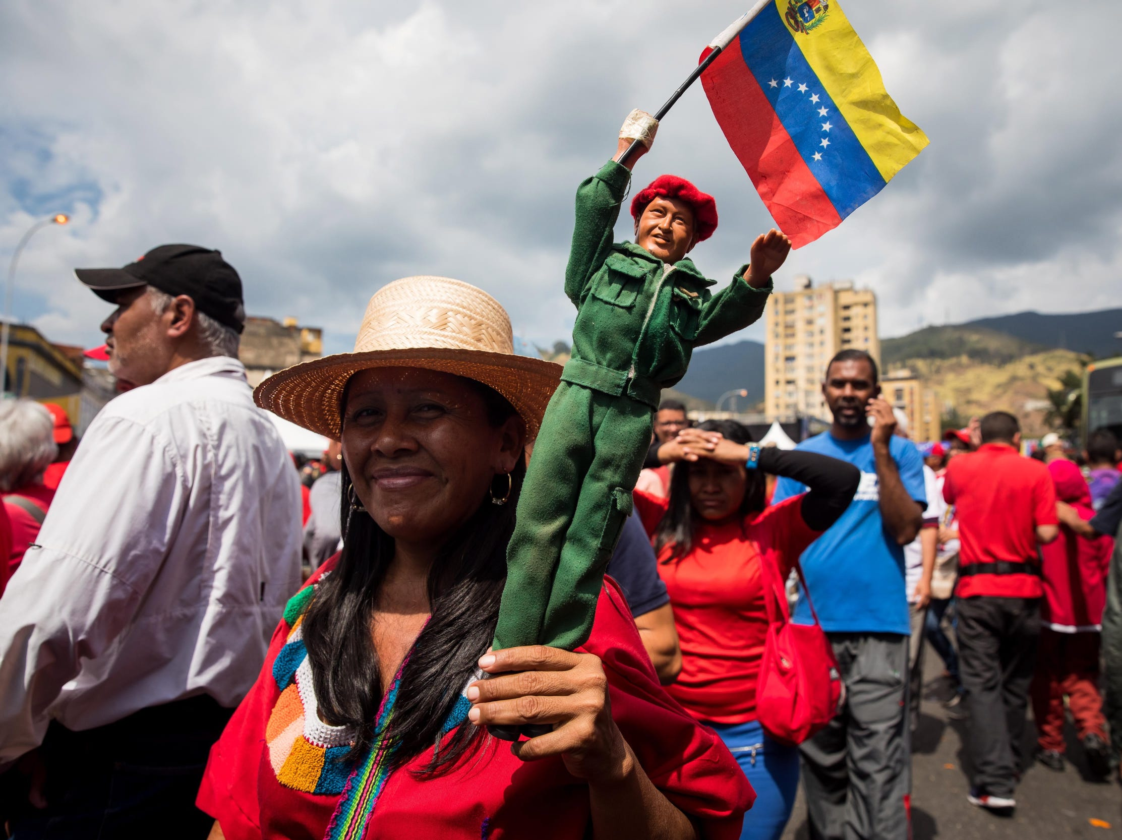 Supporters of Venezuelan President Nicolas Maduro celebrate his investiture, in Caracas, Venezuela, Jan. 10, 2019. The has fallen into a new deep political crisis after National Assembly leader Juan Guaido declared himself interim president of Venezuela and promised to guide the country toward a new election as he consider last May's election not valid.