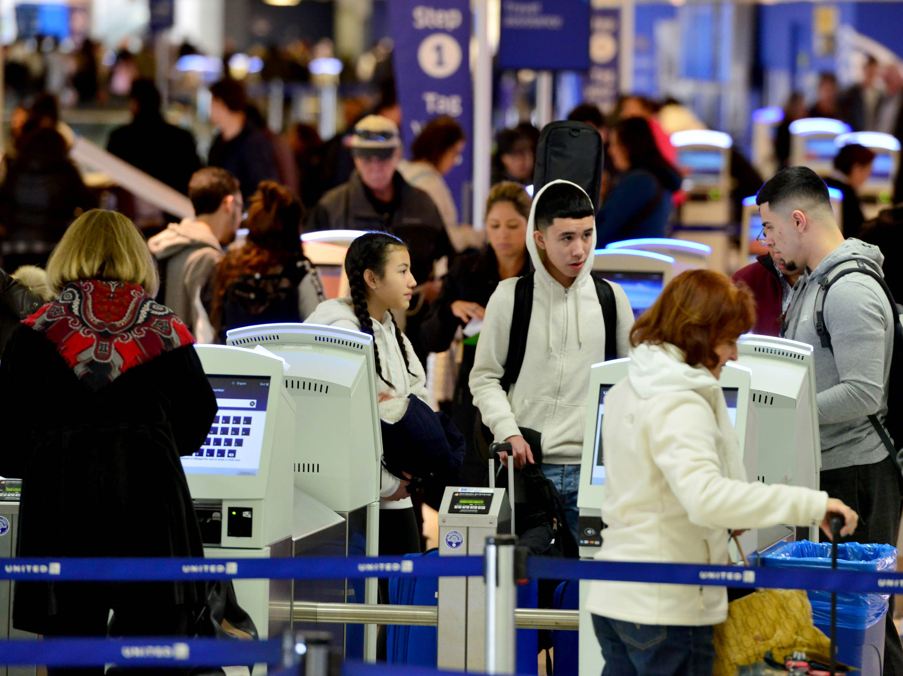 Travelers checking in for their flight at Newark Airport. Some traveller experienced the effects of the Federal shutdown while traveling in and out of the airport in Newark, Friday Jan. 25, 2019.