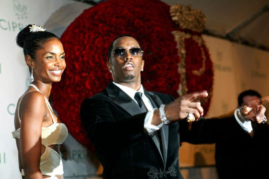 "Sean ""Diddy"" Combs  with Kim Porter, at his birthday celebration on Nov. 4, 2004."