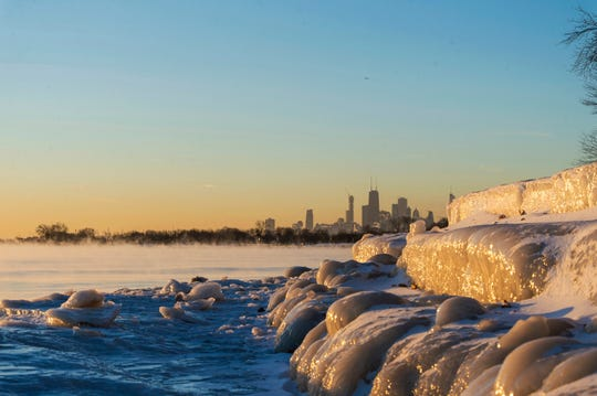 Chicago's lakefront is frozen over Friday, Jan. 25, 2019.  Another Arctic blast will freeze the upper Midwest next week.