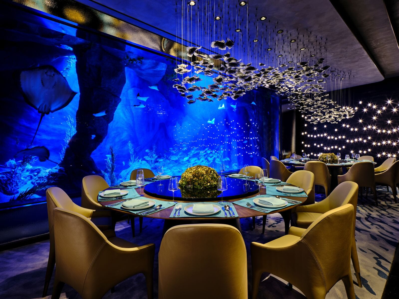 Remember those underwater floors? That's where Mr. Fisher, the seafood restaurant, entertains guests with an aquamarine display from its aquarium. Its design is meant to look like a crystal cave formed from the erosion of running water.