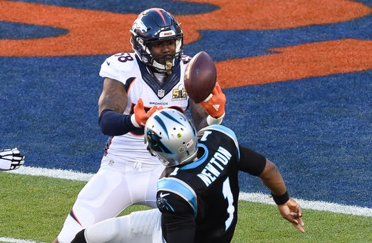 The ball goes loose as Carolina Panthers quarterback Cam Newton is sacked by Denver Broncos linebacker Von Miller during the first quarter in Super Bowl 50.