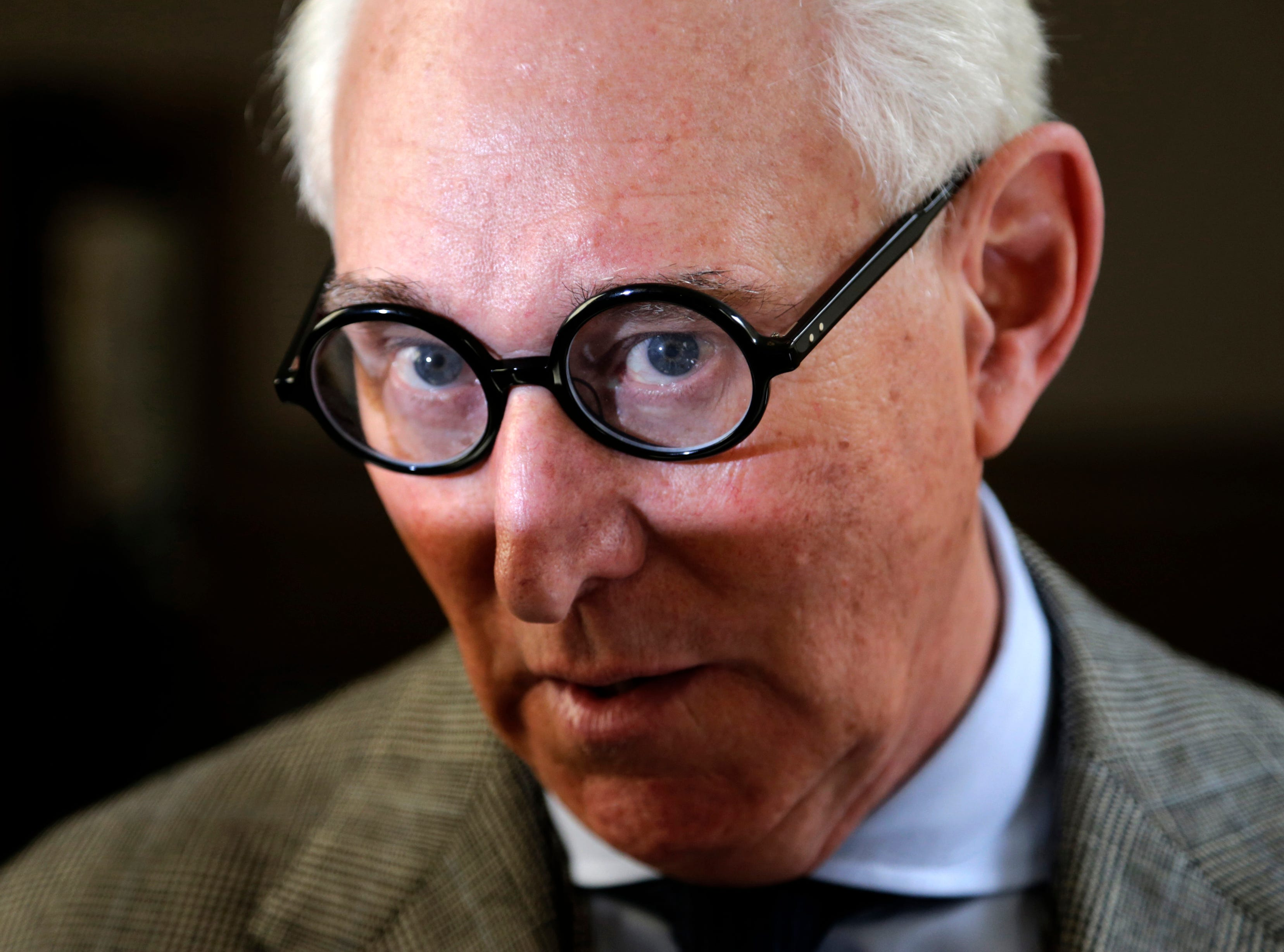 In this March 30, 2017 photo, Roger Stone talks to reporters outside a courtroom in New York.