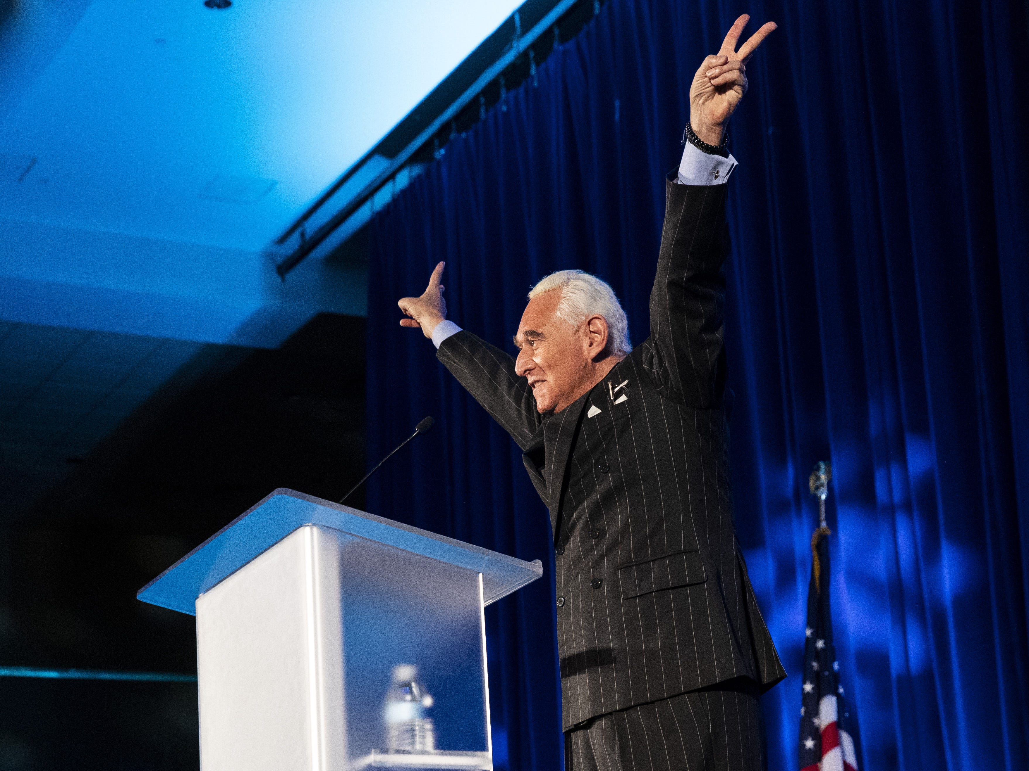 Political strategist Roger Stone gestures while speaking at the American Priority Conference, December 6, 2018 in Washington.