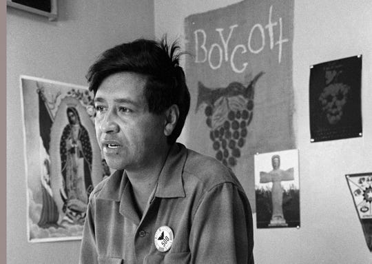 In this 1965 file photo, Cesar Chavez, then a farm worker labor organizer and leader of the California grape strike, speaks from a Delano, California, union office.