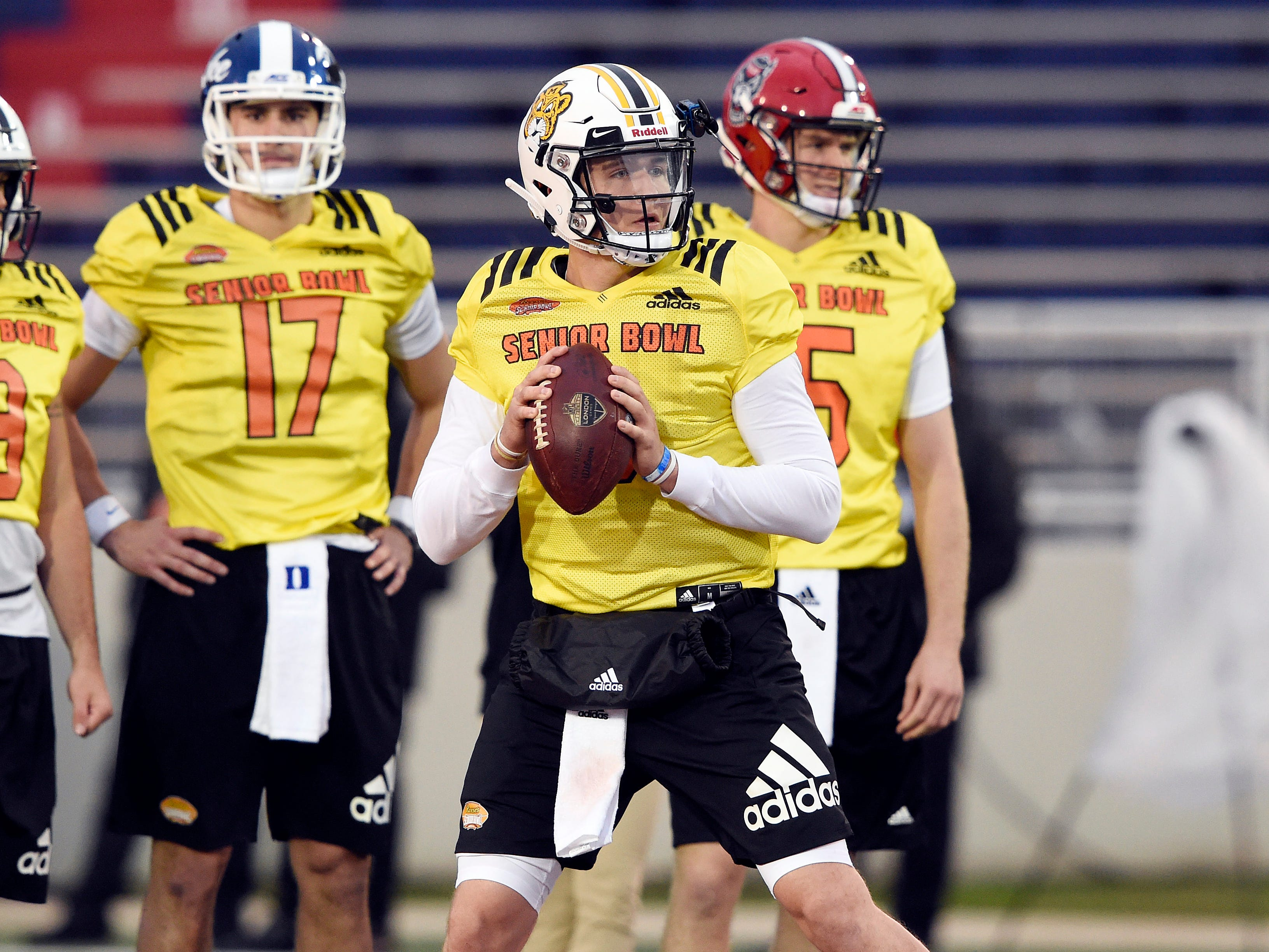 Drew Lock of Missouri drops back to pass during the North squad practice at the Senior Bowl.