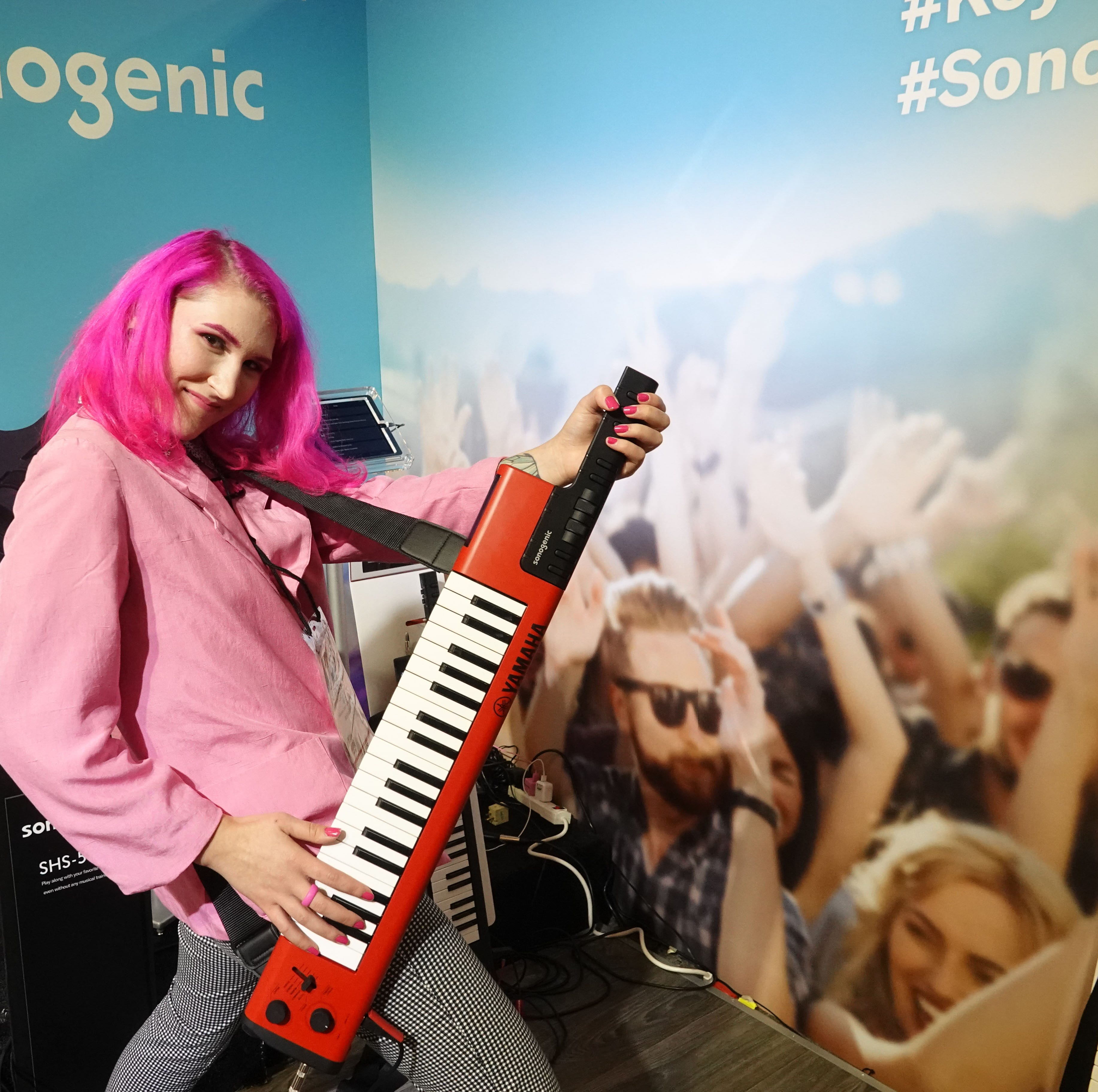 "Demonstrating the Yamaha Sonogenic ""Keytar"" a $299 keyboard designed for young people who don't know how to play. Software enables users to play along with songs in key; they can also play normal piano as well."