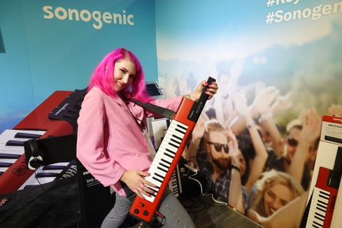 "The singer/songwriter PLASMIC demonstrates the Yamaha Sonogenic ""Keytar"", a $299 keyboartd for young people who don't know how to play. Software enables users to play along with songs in key; they can also play normal piano as well."
