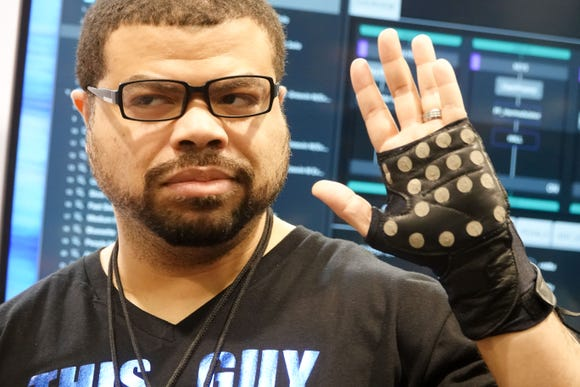 Musician Eric Parker plays beats on this $299 KAIKU glove, which connects to bluetooth and a smartphone or tablet.