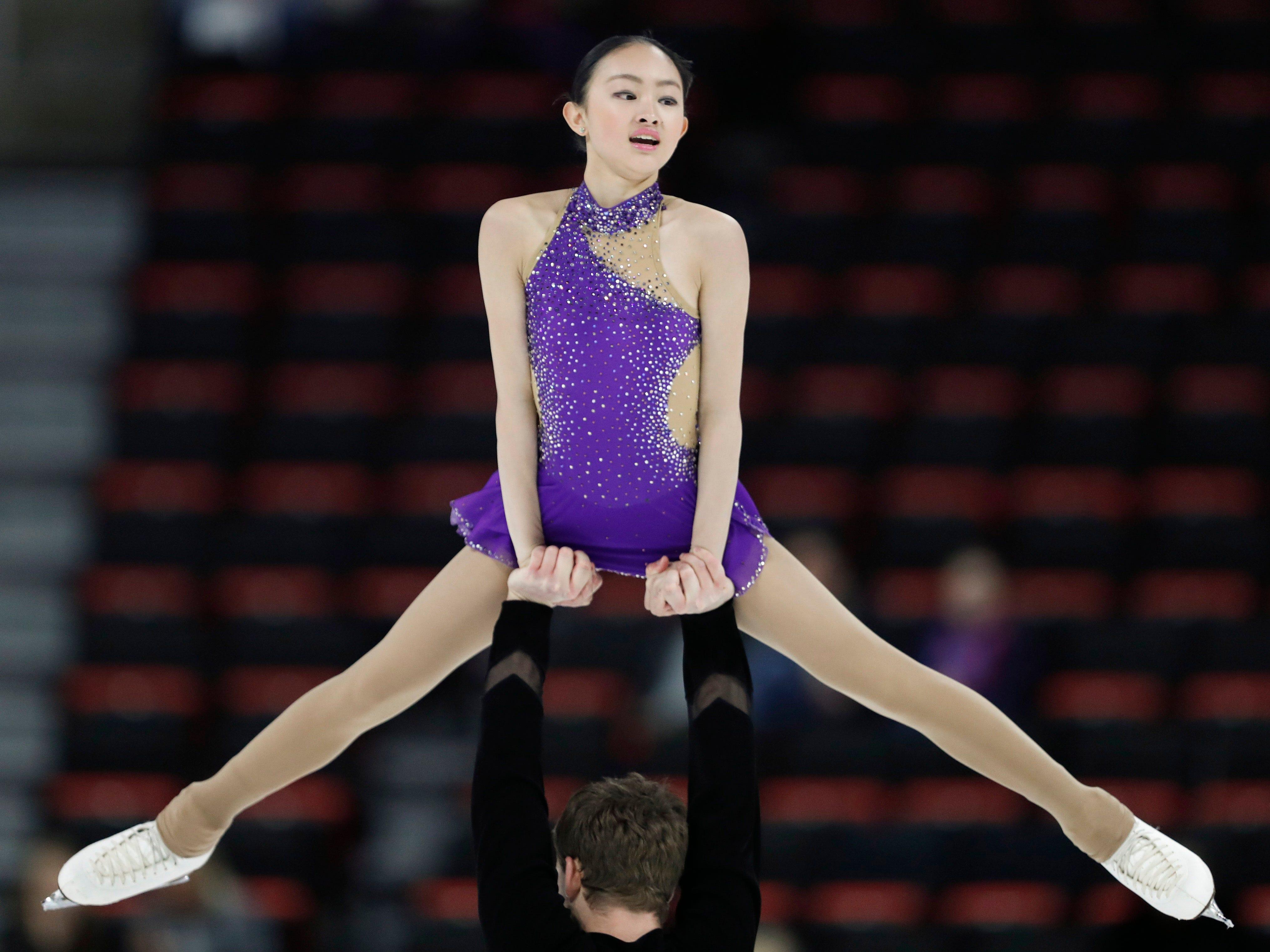 Audrey Lu and Misha Mitrofanov perform in the pairs short program.