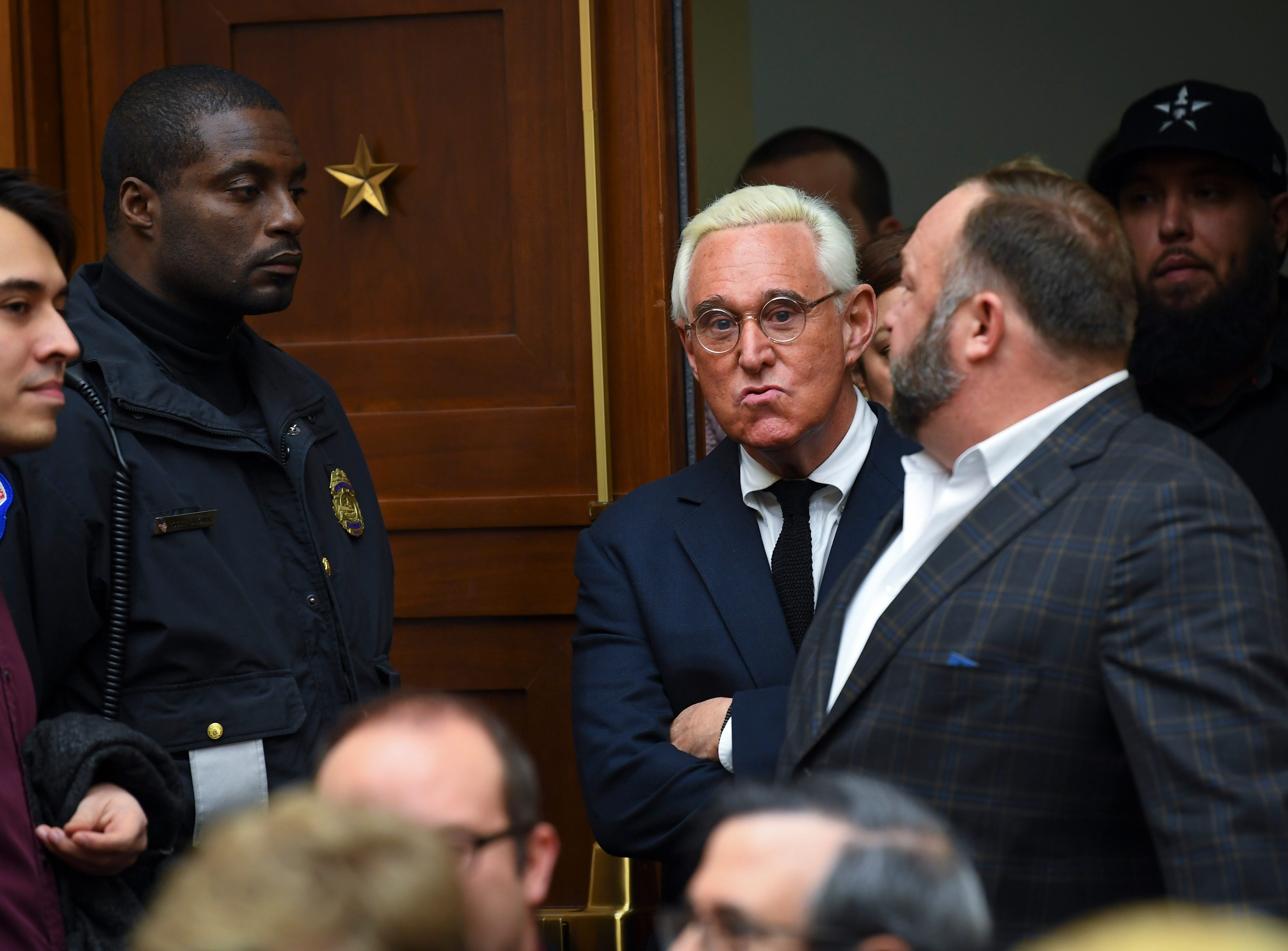 Roger Stone, center, and Alex Jones, right, arrive to sit in the public seating as Sundar Pichai, chief executive officer of Google, testifies to House Judiciary Committee about the company's data collection practices on Dec. 11, 2018 in Washington.