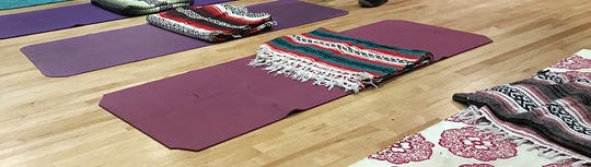 Yoga mats are lined up in the theater room at Taos High in New Mexico ahead of a meditation activity meant to help students develop new skills to deal with grief and loss.