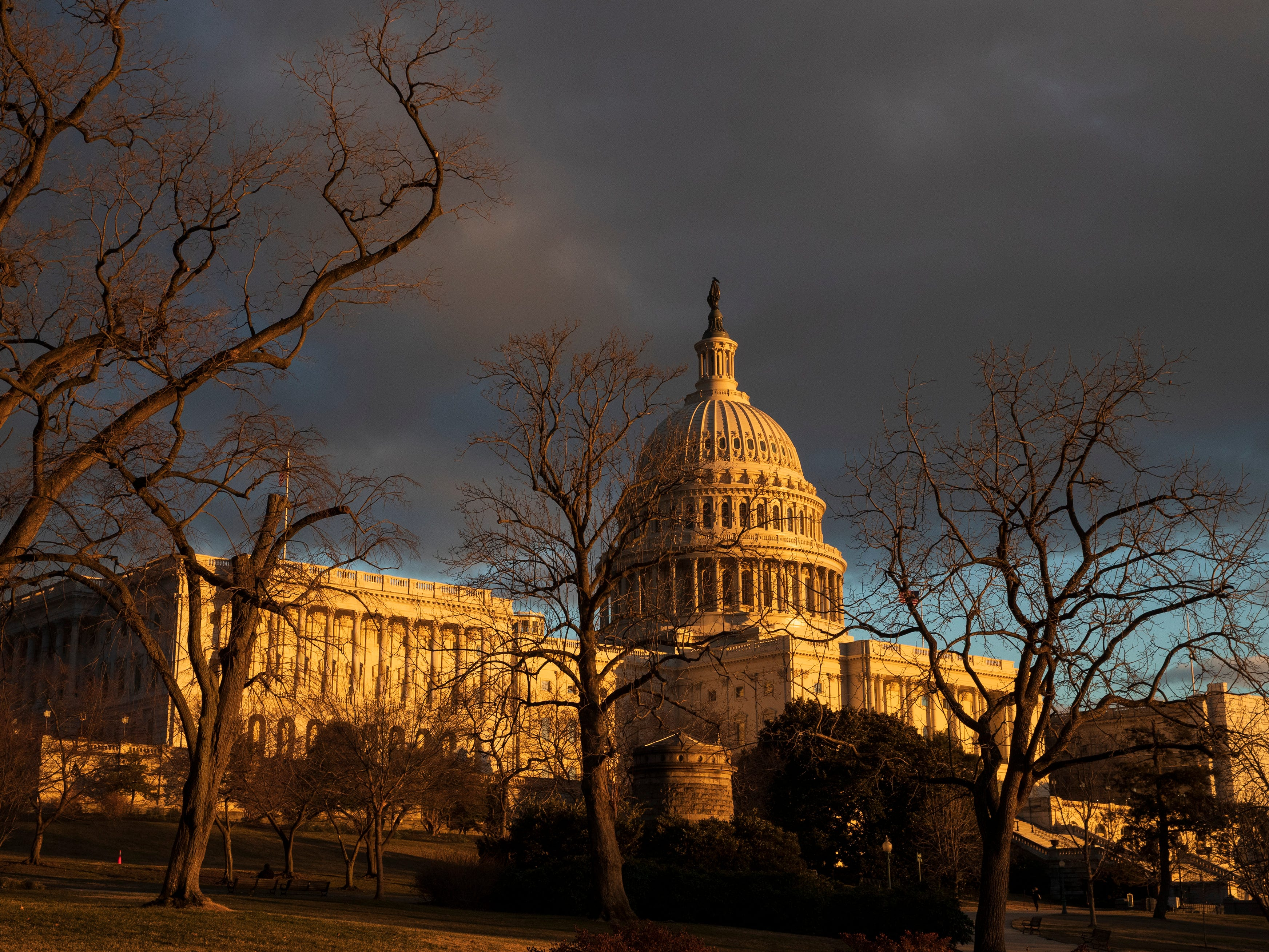 The Capitol is seen under dark skies at sunset after the Senate rejected competing Democratic and Republican proposals for ending the partial government shutdown, which is the longest in the nation's history, in Washington, Thursday, Jan. 24, 2019.