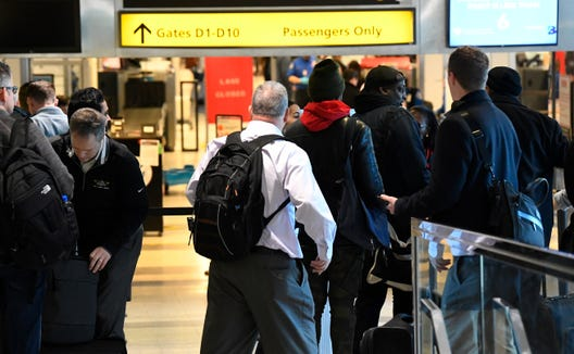 Passengers move through Central terminal B security check-in at New York's LaGuardia Airport.
