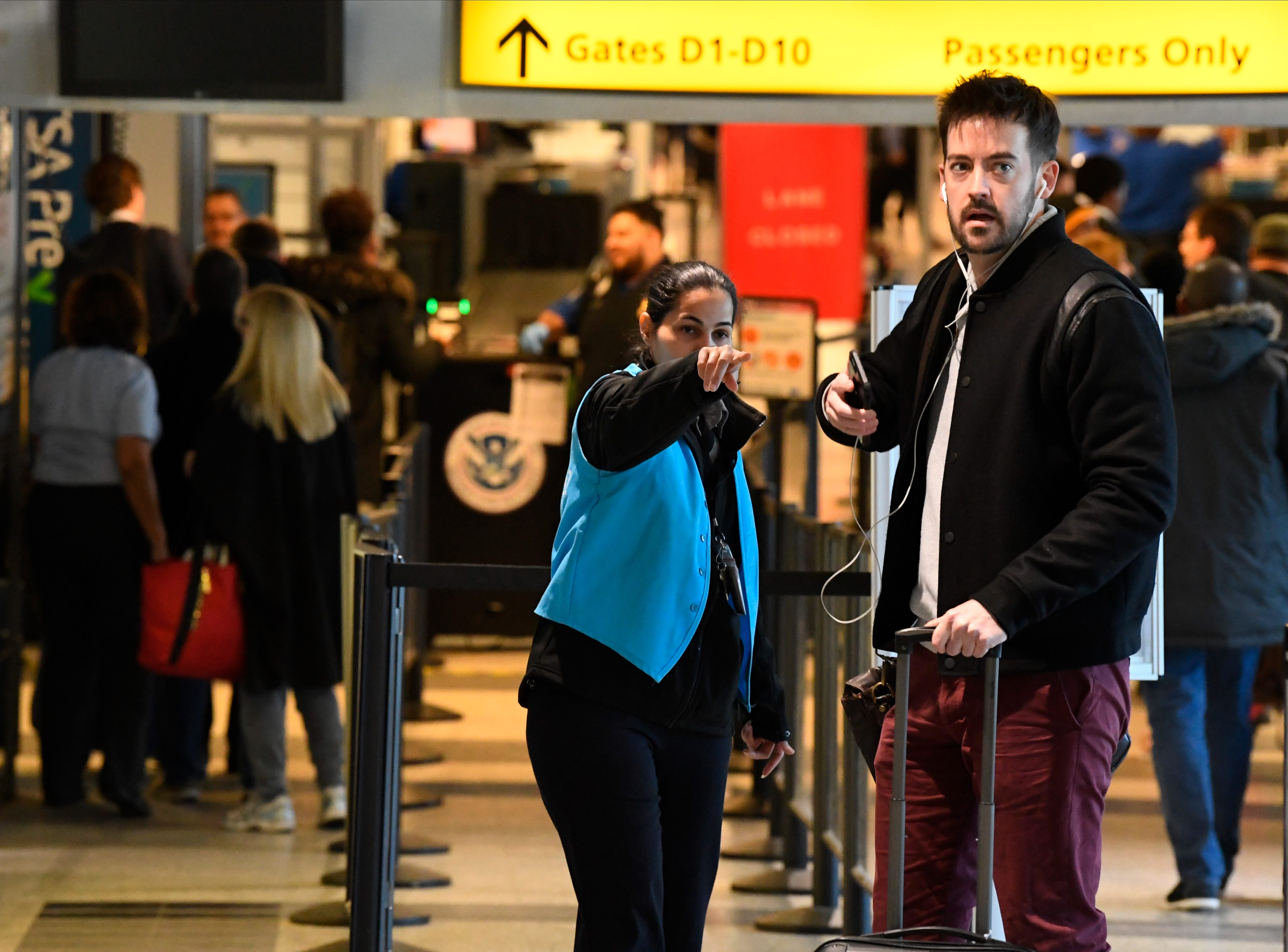 A passenger gets help at Central terminal B security check-in. Staffing issues related to the government slowdown caused delays at New York's LaGuardia Airport .