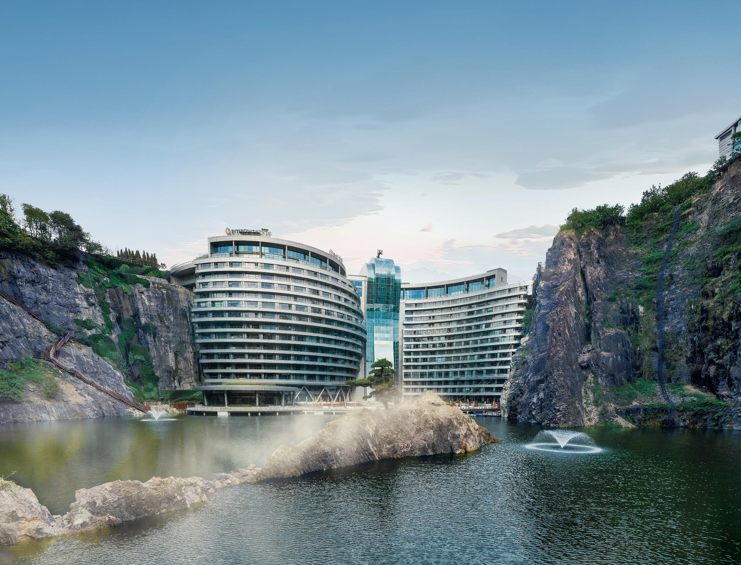 Located 30 miles from downtown Shanghai, this 18-floor building is a feat of architectural design. One floor of accommodations is underwater offering aquarium-facing guest rooms and a restaurant while the rest of the hotel sinks nearly 300 feet below the Earth's surface above. It was built inside an abandoned quarry and today serves as a tourist resort destination.