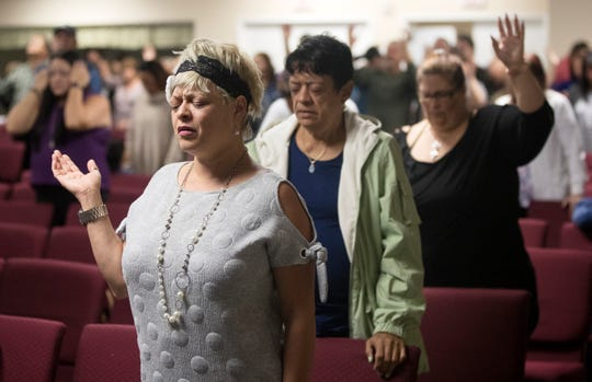 Jessica de Arce was among hundreds of people attending a memorial service for Marisol Lopez on Thursday at Nuevo Pacto United Methodist Church in Sebring, Florida. Lopez was one of five people killed in a shooting in a SunTrust Bank on Wednesday in Sebring.