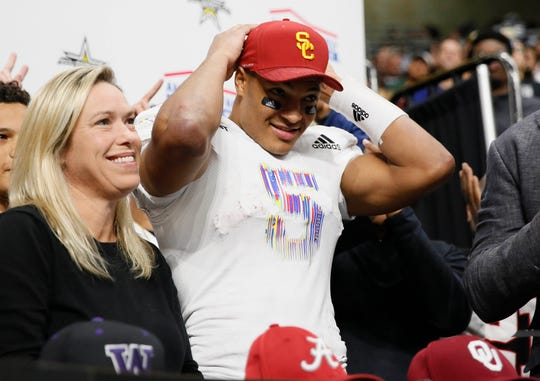 Bru McCoy puts on a Southern California hat while making his commitment during U.S. Army All-American Bowl high school football game.